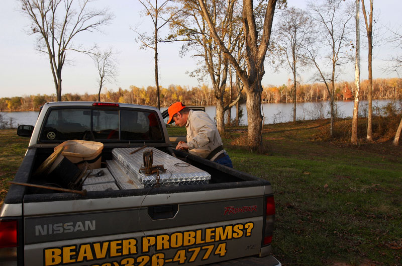 Trapper and Animal Control Officer Harold Renfro collects a snare trap from the back of his truck in Shreveport, Louisiana December 6, 2008.
