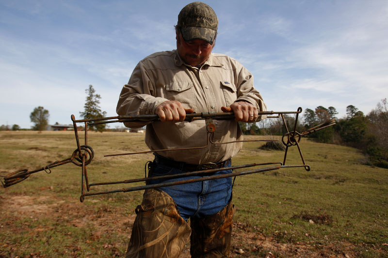 Trapper and Animal Control Officer Harold Renfro sets a beaver trap in Henderson, Texas December 6, 2008.