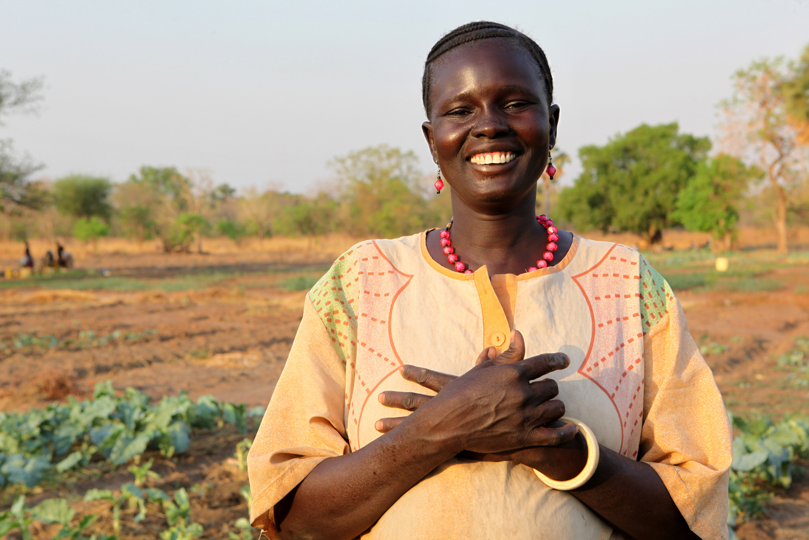 Women for Women International Sudan Chapter runs the Pacong Community Farm for women from Rumbek East, Lakes State, South Sudan. The farm supports vegetable farming, an aviary honey project, livestock and poultry. Debora Alaek Malek irrigates her crops daily from 5-7pm.