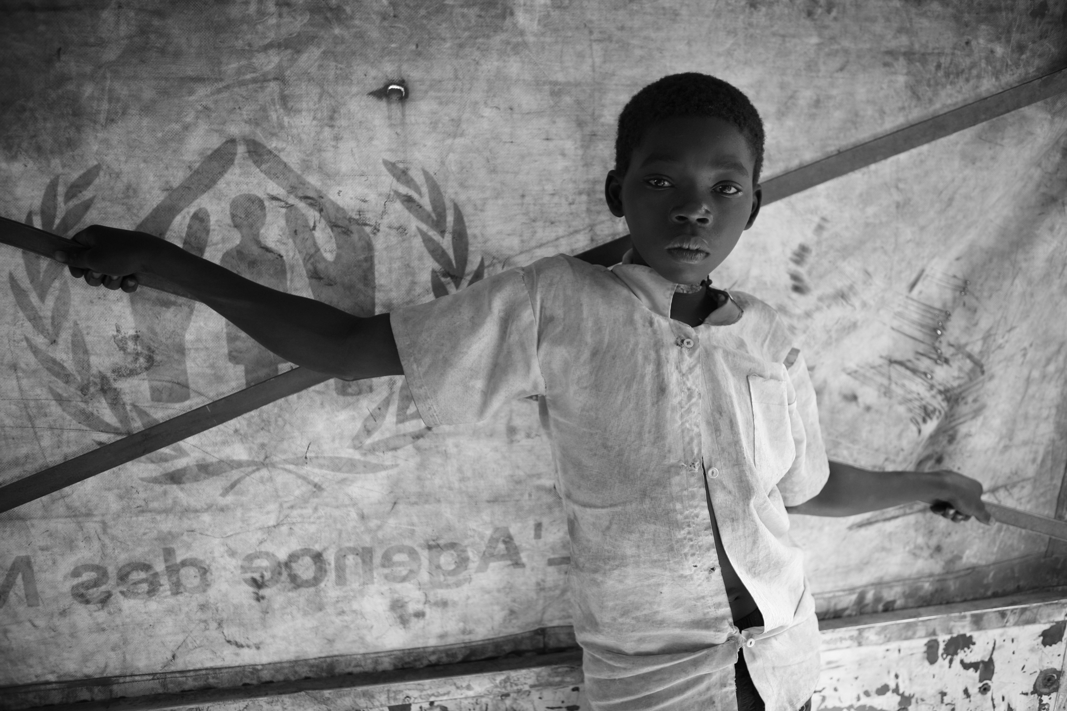 Birunga, age 13, escaped alone from his village in Democratic Republic of Congo after his father was killed by the LRA. He was taken in by a Sudanese family in Gangura, and continued his journey by truck with 61 other Congolese refugees to Makpandu. Birunga traveled with only the clothes on his back and two new bicycle tires, which he was going to sell in the Nabiapai market when he fled. UNHCR will place him with a family at the Makpandu site while attempting to locate his relatives.