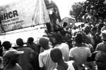 A flood of Congolese refugees wait for the trucks to arrive to Makpandu every Monday, Wednesday and Friday, hoping to reunite with family members as they arrive from Gangura.