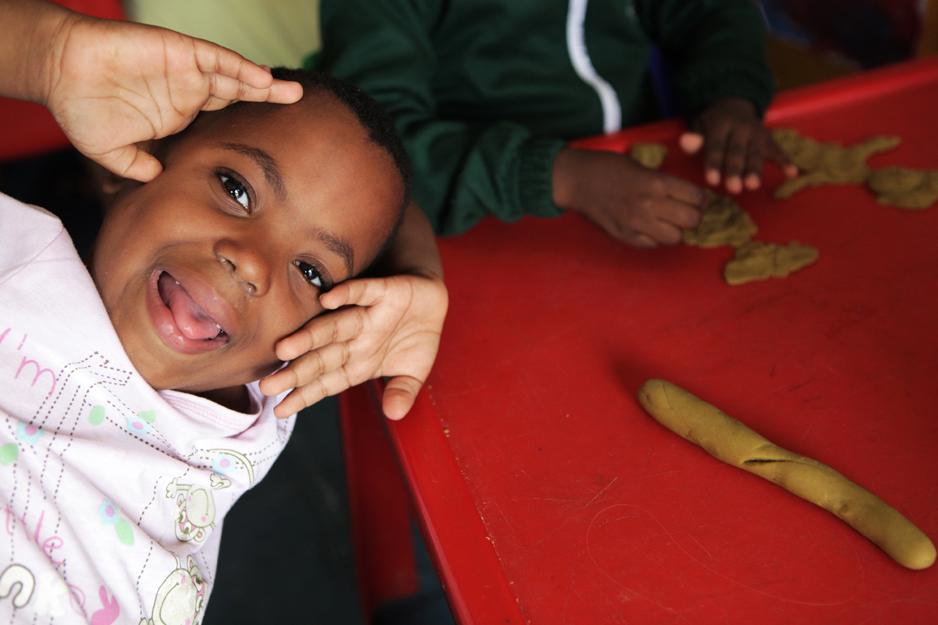 Owethu, 5, plays with Playdoh at the Little David Educare Centre in Wentworth, a township on the southern side of Durban, in KwaZulu-Natal province. Over 92% of preschool children in KwaZulu-Natal attend unregistered ECD centres (crèches). Save the Children, operating in KZN for over 50 years, recognised the need to support crèches in the area with better management skills and access to learning materials, as well as running the crèche forums and supporting crèches with registration to become ECD centres.