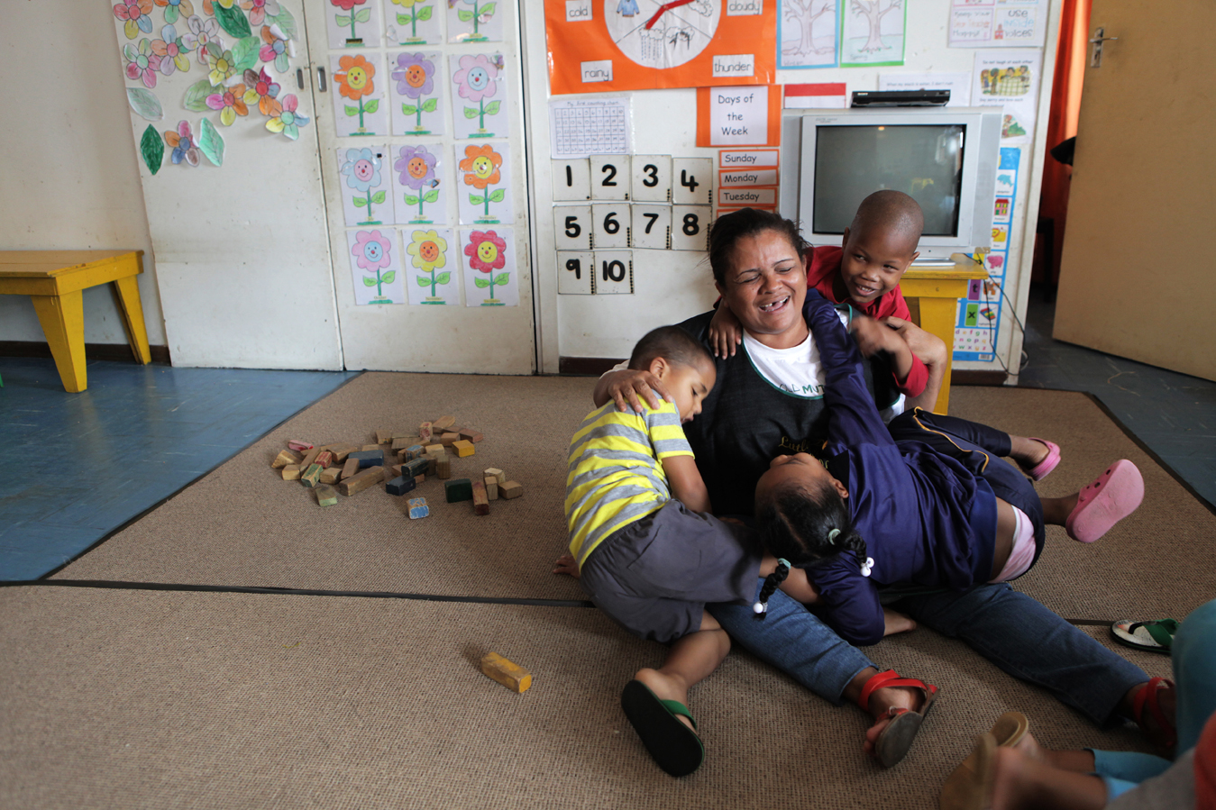 Noblene Boyles, 40, is an ECD teacher at the Little David Educare Centre in Wentworth, a township on the southern side of Durban, in KwaZulu-Natal province. She has been teaching at Little David for seven years, and was recently awarded the 2013 ABSA ECD Award of Excellence for KwaZulu-Natal. She goes on to compete at the national level in February 2014. Over 92% of preschool children in KwaZulu-Natal attend unregistered ECD centres (crèches). Save the Children, operating in KZN for over 50 years, recognised the need to support crèches in the area with better management skills and access to learning materials, as well as running the crèche forums and supporting crèches with registration to become ECD centres.