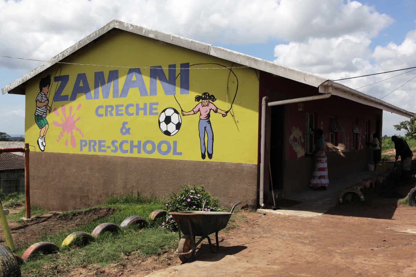 The Zamani ECD Centre on the outskirts of Durban in the eThekwini district. Principal Ethel Ngcobo first opened as a crèche in 1995, responding to the need for children to be cared for while their parents were at work. After years of dedication and support from ABSA, the Outreach Foundation and Save the Children, she built a proper ECD centre. Over 92% of preschool children in KwaZulu-Natal attend unregistered ECD centres (crèches). Save the Children, operating in KZN for over 50 years, recognised the need to support crèches in the area with better management skills and access to learning materials, as well as running the crèche forums and supporting crèches with registration to become ECD centres.