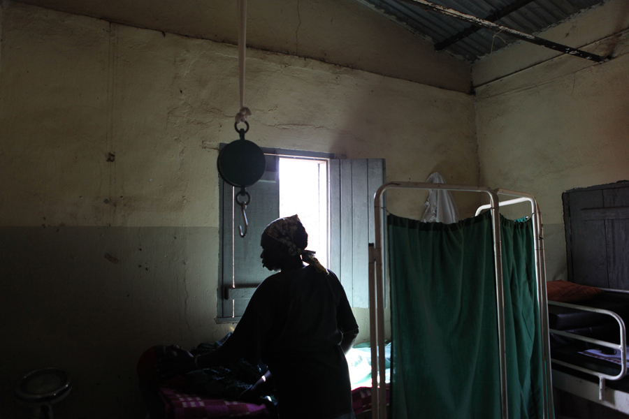 Midwife Esther Minyala examines an expecting mother in the Ante-Natal Center of the Mvolo Primary Health Care Center (PHCC). The Mvolo PHCC is supported by Save the Children and managed by the Government of South Sudan Ministry of Health.