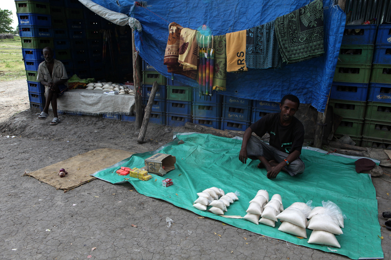 An empty market in Pibor, Jonglei State. The only things available are non-food items, sugar, salt and very expensive white flour. 50kg of flour costs 500 SDG, more than the best quality bull in town. Pibor is one of the largest villages of the Murle people, who are an entirely nomadic community of cattle herders. Violence and displacement in March, along with a non-productive rainy season, has led to food shortages in the market because boats can't travel the river and trucks won't pass on the roads for security reasons. Malnutrition is reaching acute levels in the area and MSF is the only healthcare providing organisation operating in Pibor.