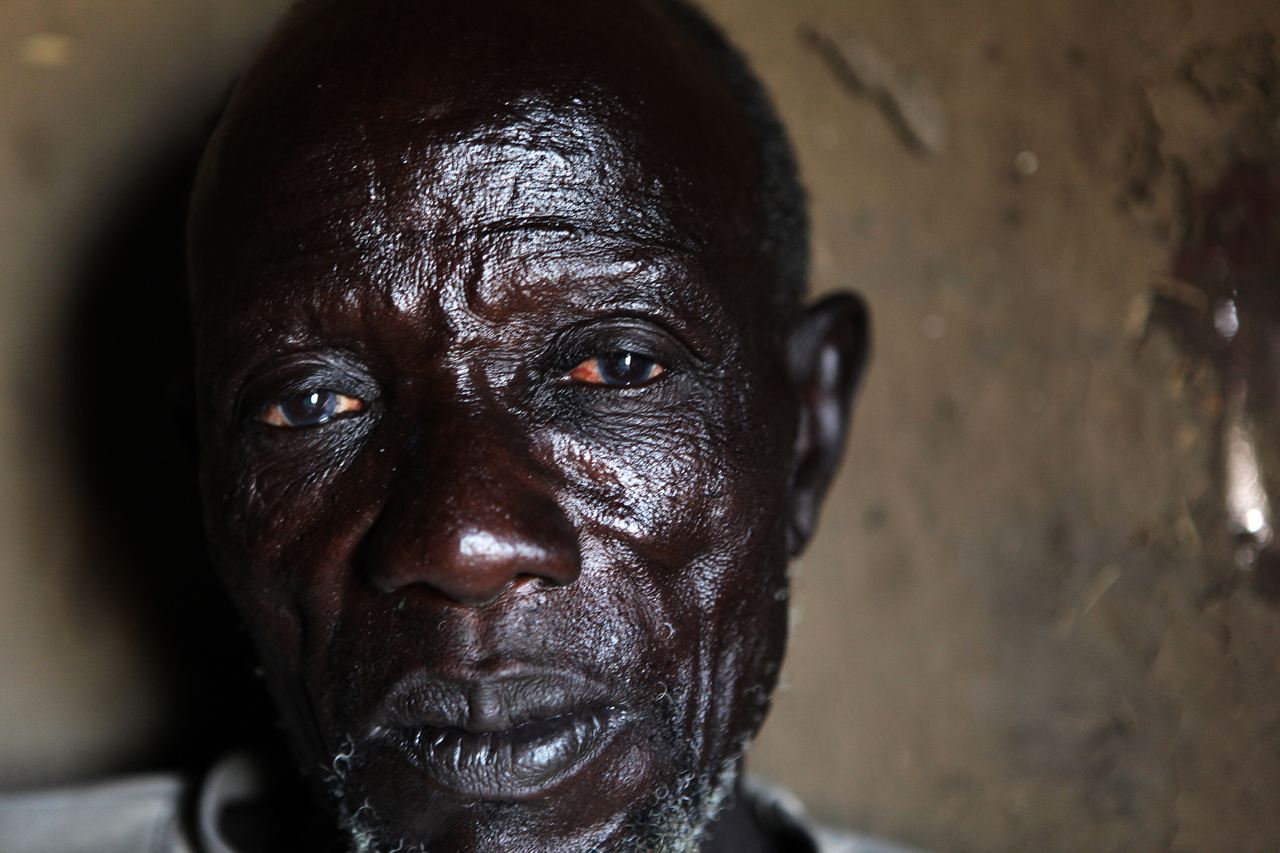 'Seven of my wives were killed and I remain with three. When they were killed, we buried them in Wechlita Cattle Camp after the Lol Nuer left. Not only one person was buried in one hole. Three people were buried in one hole, or 4 or 5, even 7, because the strong men were not there to dig the graves. The relatives who came to visit buried the dead people.'Reath Tongyik, 75, the oldest survivor of the Torkej attack returns during daylight to dismantle his tukul. Seven of Reath's ten wives were killed and he is terrified to resettle in Torkej for fear of another violent attack.