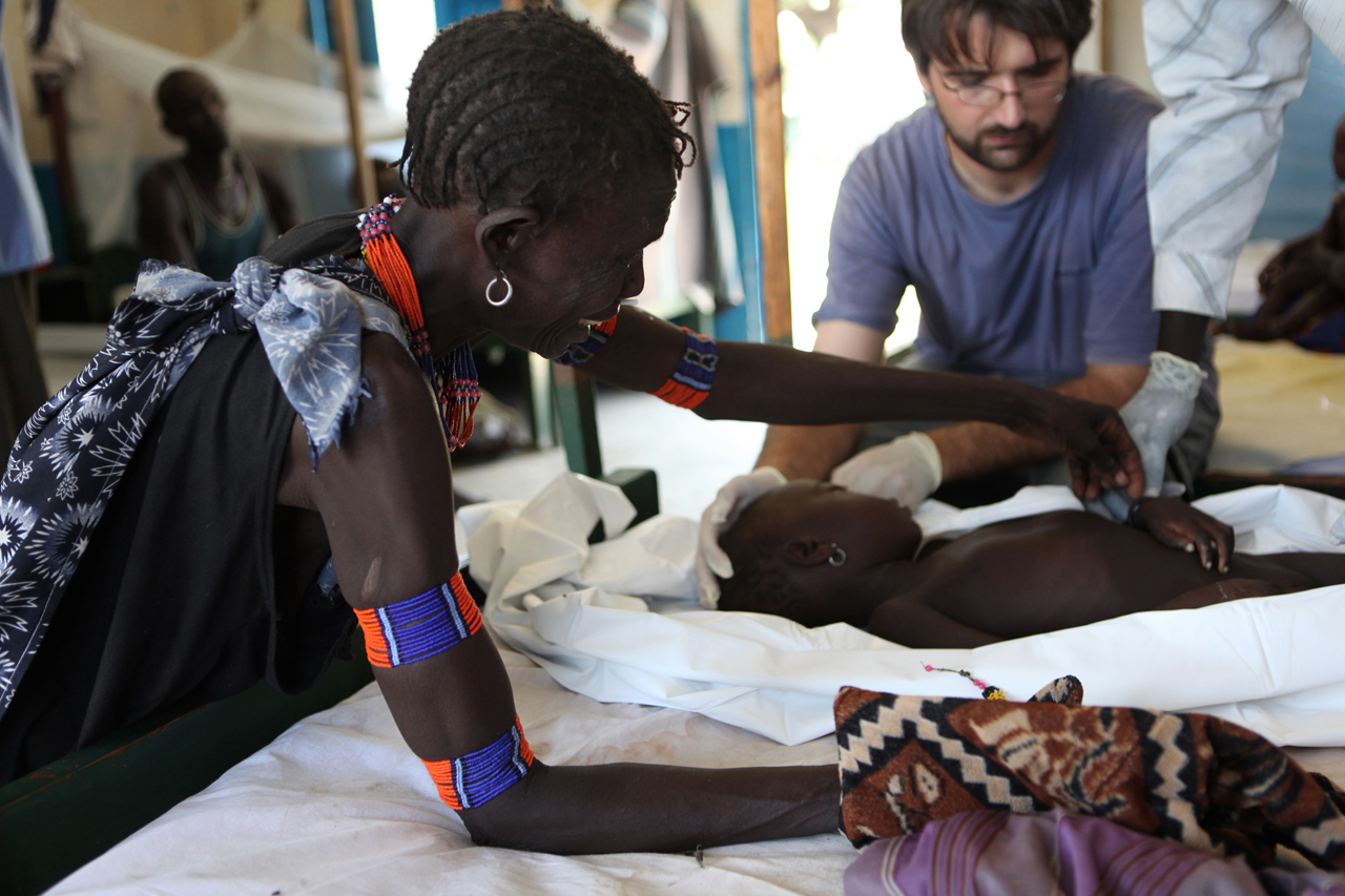 Grandmother of Kidich Jiji, 3, who died from cerebral malaria in the MSF Primary Health Care Center (PHCC) Pediatric Inpatient Ward in Pibor, Jonglei State. Kidich was transferred from a remote MSF Primary Health Care Unit (PHCU) in Gumuruk, after convulsions and coma. Pibor is one of the largest villages of the Murle people, who are an entirely nomadic community of cattle herders, and MSF is the only healthcare providing organisation operating in the area.