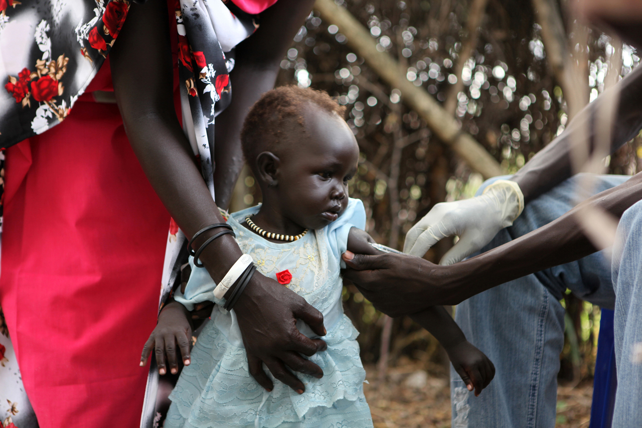 MSF Vaccination Campaign in Pibor, Southern Sudan, to vaccinate thousands of women and children against Polio, TT, DPT, and Measles. The campaign also offers the MUAC test for malnutrition in children under 5. Pibor is a remote area of Jonglei State, yet a major town center for the Murle tribe in Southern Sudan.