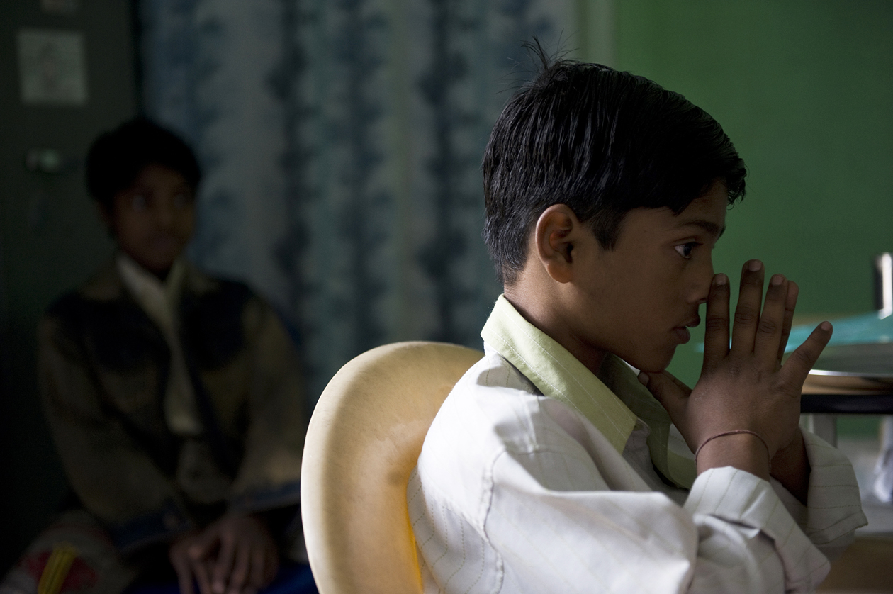 HIV positive Vicky Lakhan, 13 years old, prepares to take his Anti-Retroviral medication. His younger brother, Rahul, age 10, is HIV negative. His father was infected with HIV from a dirty syringe in 1994, where he had sought treatment from a village doctor in Bihar, India.