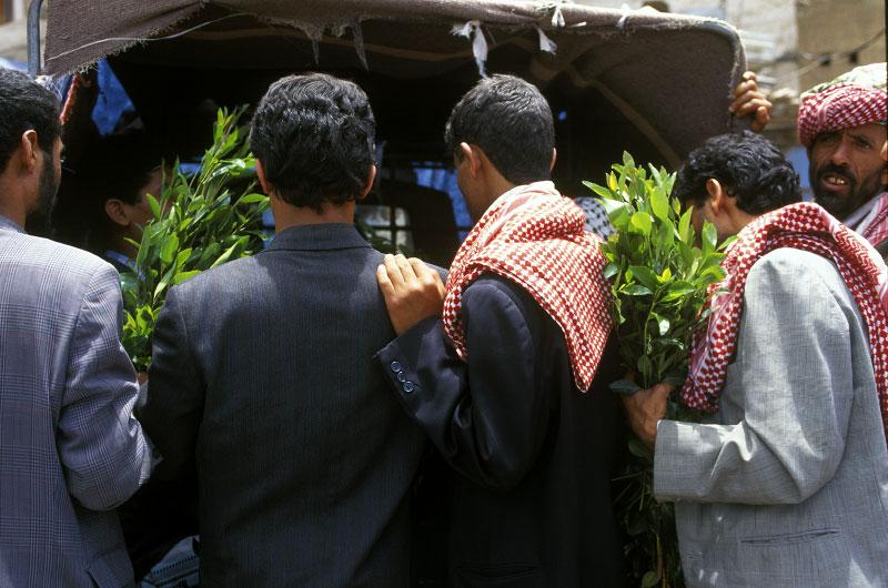 Men buying qatSana'a, Yemen