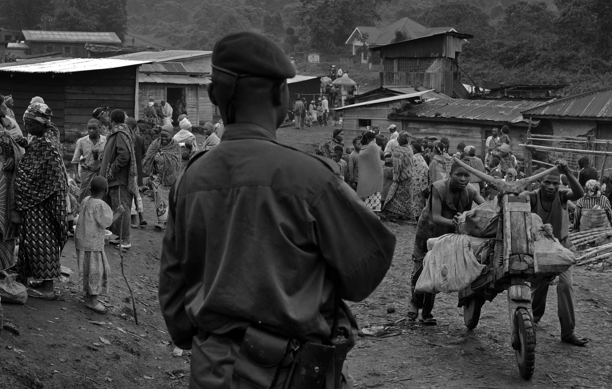 Members of the Congolese Army patrol the village of Kibumba, Democratic Republic of the Congo (DRC), which lies in an area that was recently controlled by Congolese rebel general Laurent Nkunda.  Nkunda was the leader of a rebel faction (CNDP) operating in the province of North Kivu of the DRC that was sympathetic to Congolese Tutsis and the Tutsi-dominated government of neighbouring Rwanda.  Nkunda was recently captured during a joint operation between the Congolese and Rwandese militaries.  Rwanda military operatives moved through the village of Kibumba en route to disarm a Rwandan Hutu militia that has been operating inside Eastern Congo.