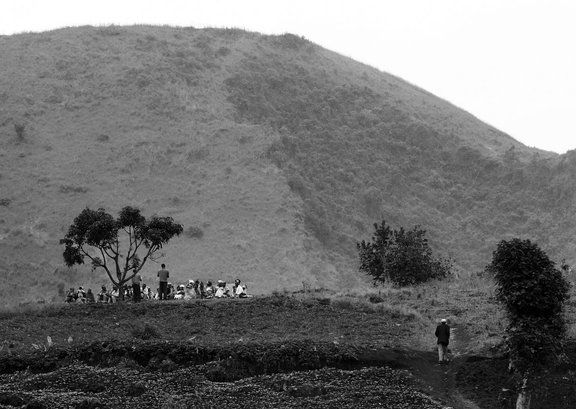 A church group of internally displaced people (IDP's) hold service in the hills above their camp in Magunga, Demcratic Republic of Congo.