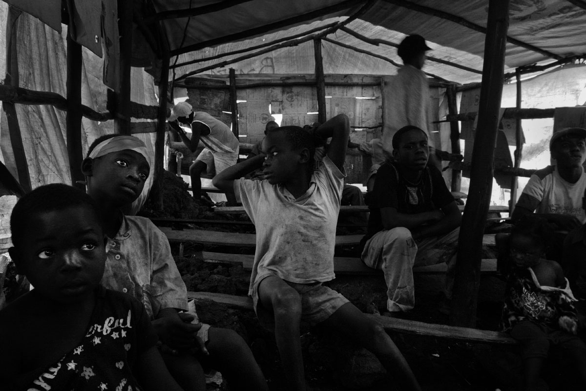 Youngsters watch television in a {quote}movie house{quote} in Magunga Camp on the outskirts of Goma, Demcratic Republic of Congo.