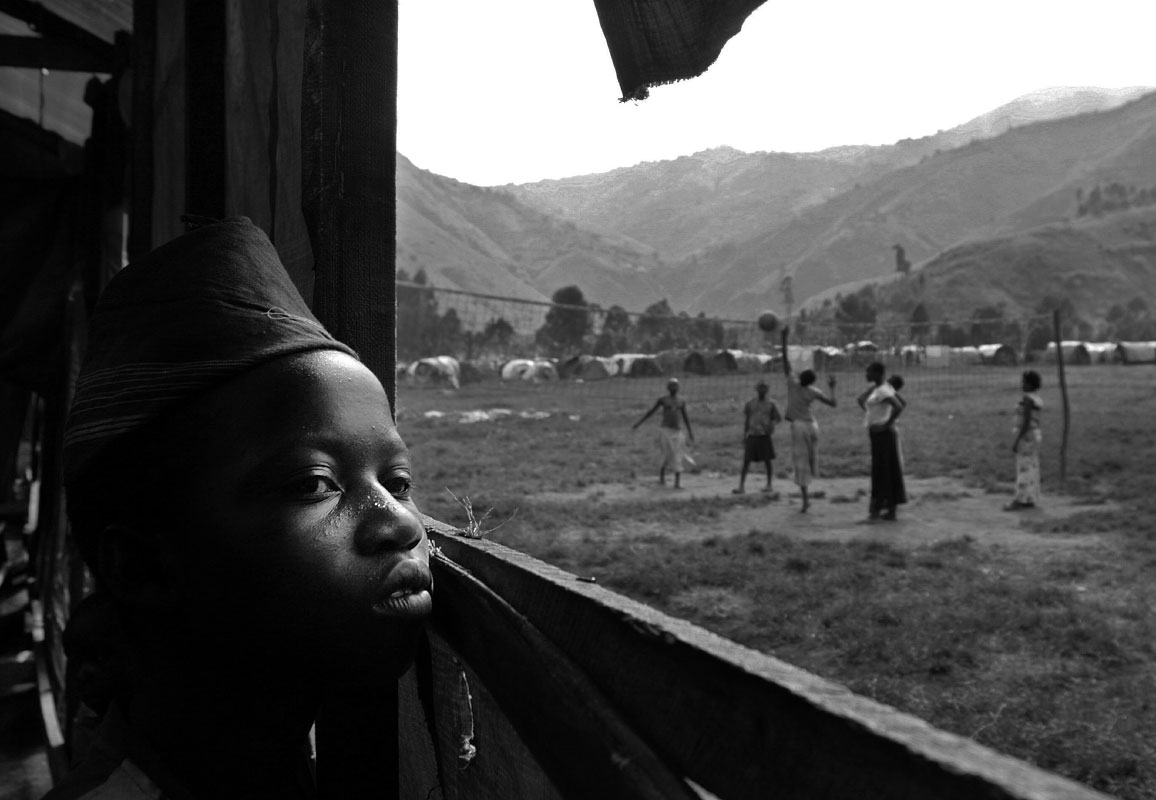 A child looks out on the Shasha Camp for internally displaced people in Shasha, Democratic Republic of Congo.  As a joint Congolese/Rwandan military operation to disarm Rwandan Hutu rebels takes place in Eastern Congo, some feel like their villages are now safe to re-inhabit while fresh refugees are arriving at the camps because of new violence near their homes.