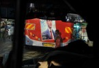 An image of president-elect Barack Obama is posted on the back of a bus.  Kisumu, the country's third largest city, sits on the northeast edge of Lake Victoria.