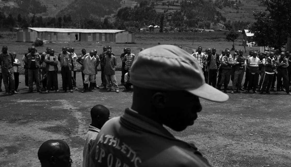 Former military rebels and their families, who have chosen to demobilize and repatriate back into their respective societies, go through lessons in the order of the camp at Camp Mutobo in Mutobo, Rwanda.  The Rwandan government is zealously encouraging that effort. Genocide survivors are urged to forgive and to live in villages with former killers -- and, indeed, many people bite their tongues these days rather than describe anyone as a Tutsi or a Hutu. In the case of the returning rebels, the government runs a kind of boot camp aimed at transforming them into model citizens.