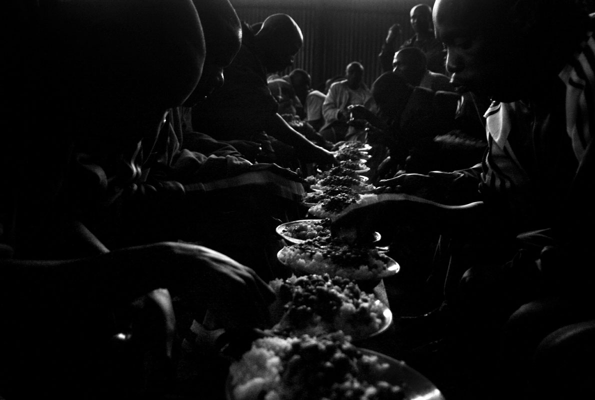 Former military rebels and their families eat in an orderly fashion at Camp Mutobo in Mutobo, Rwanda.