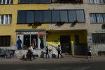 SARAJEVO, BOSNIA AND HERZEGOVINA.  People walk passed a building that shows a lack of certainty with regard to the facade's colors and windows on October 11, 2014.  As Sarajevo was restored after the 1992-1995 siege according to private property regulations as opposed to the previous state order which allowed for less dissonance and continuity of styles.