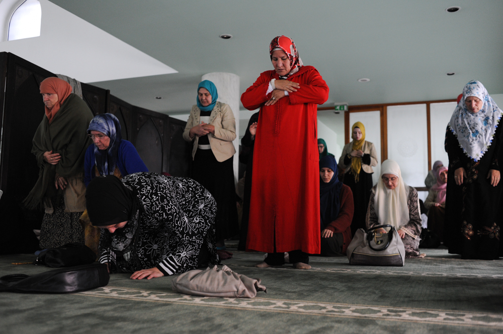 SARAJEVO, BOSNIA AND HERZEGOVINA.  Women pray on the upper level in the small section partitioned for them in the Wahhabi King Fahd Mosque, designed by Faruk Kapidzic, during Friday prayers and Herzegovina on October 10, 2014.