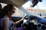MASTAGAH, AZERBAIJAN.  Sumara Aliyeva, 32, an animal rights activist, drives with a kitten rescued from the street of central Baku in her lap in the Baku suburb on October 8, 2011.