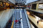 SARAJEVO, BOSNIA AND HERZEGOVINA.  Children ride the escalators for entertainment at the massive Saudi-owned Sarajevo City Center mall designed by architect Sead Golos on October 16, 2014.  Alcohol is not served in any of the mall's restaurants due to the mall's Saudi ownership, to the objections of the architect.