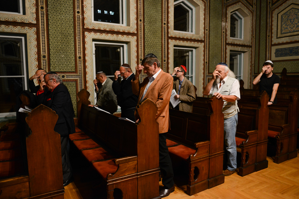 SARAJEVO, BOSNIA AND HERZEGOVINA.  Sephardic Jews pray in the Ashkenazi Synagogue on shabbat on October 17, 2014.  Jewish community leader Jakob Finci (second from right) placed the number of Jewish people left in Sarajevo at 700; part of the Shabbat service is in Ladino, an old dialect of Spanish that Jews expelled from Spain in 1492 took with them to their new homes across the Mediterranean world.