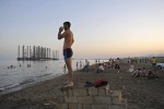 BAKU, AZERBAIJAN.  The Caspian beach in Sixov in Bibi Heybat section on July 4, 2010.  With offshore oil installations and an abundance of trash, the Sixov beach is only frequented by the rural and downtrodden from the Azerbaijani regions beyond Baku who cannot afford the private beaches where the elite go to isolate themselves.