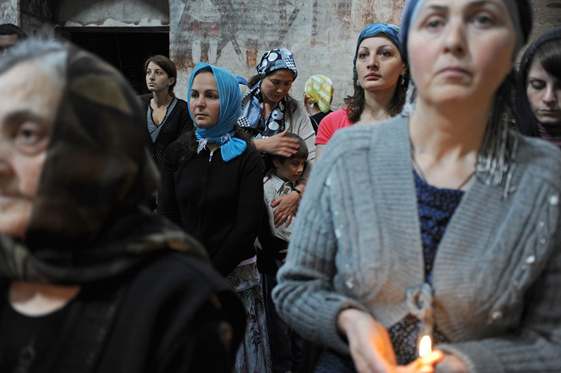 TIMOTESUBANI, GEORGIA.  Worshippers during Sunday mass in the Timotesubani Church on July 25, 2010.  Located in the Borjomi gorge, the Timotesubani Church and monastic complex is a few kilometers from the Baku-Tbilisi-Ceyhan (BTC) oil pipeline route, making it perhaps the most religious sites along the BTC route in Georgia, the only Christian country traversed by the oil pipeline.