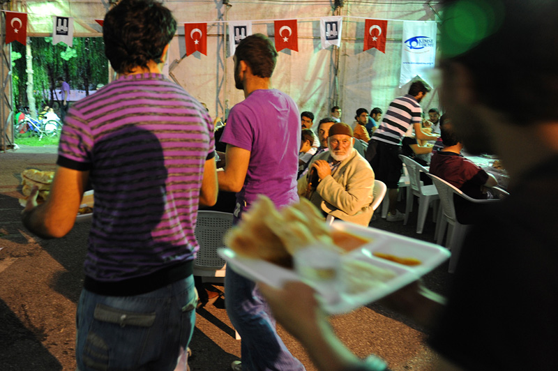 ERZURUM, TURKEY.  People take their seats inside an Iftar tent, when Muslims break their fast after abstaining from food and drink during the day on the second night of the month long celebration of Ramadan, the first major city near the route of the Baku-Tbilisi-Ceyhan oil pipeline in Turkey, located just 10 kilometers from the pipeline which traverses numerous villages near the city's airport, on August 12, 2010.