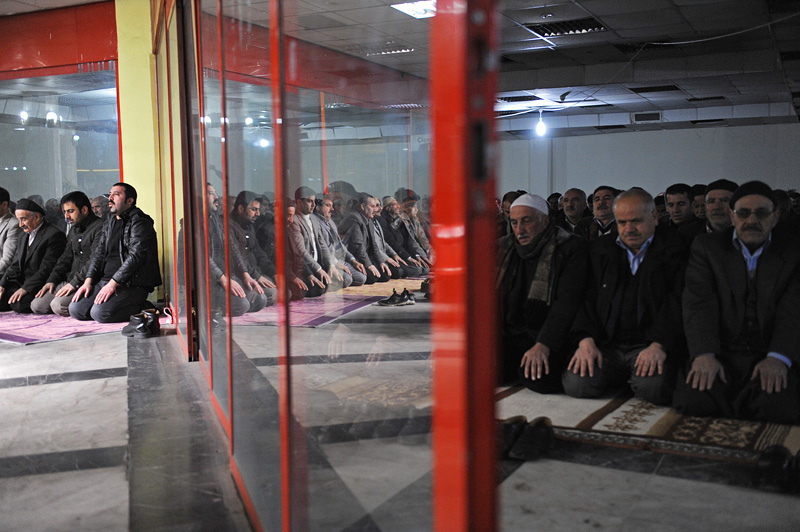 DIYARBAKIR, TURKEY.  Men pray in an underground shopping center during a weekly protest called {quote}civil Fridays,{quote} where men hear prayers from a Kurdish speaking imam not approved by the Turkish state, as an act of civil disobedience in Diyarbakir, Turkey on February 24, 2012.  In Turkey, mosques fall under the control of the Turkish state and other religious activities are deemed unofficial and, on occasion, illegal; Diyarbakir is a majority Kurdish city and the most political active, restive in the Kurdish-dominated areas of eastern Turkey.