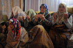 ALVAR, TURKEY.  Women sit for a reading of the Koran late morning in the home of Murat Ozturk in the village of Alvar, Erzurum region, Turkey, which is traversed by the Baku-Tbilisi-Ceyhan oil pipeline, on the first day of Ramadan, August 11, 2010.