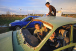 REYHANLI, TURKEY.  Syrian children play in a junkyard of old, abandoned and destroyed vehicles at the entrance to the Reyhanli tent city in Reyhanli, Turkey on February 26, 2012.  As the year old rebellion against the rule of Bashar Al-Assad continues just across the border in Syria, Turkey has seen a continued influx of refugees from the Syrian conflict but has not granted them refugee status and instead considers them to be &quot;guests&quot; of Turkey; Turkey's border with Syria is just one hour from the Ceyhan Marine Terminal where the Baku-Tbilisi-Ceyhan oil pipeline ends its 1,100 mile journey at the Mediterranean port.