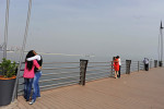 BAKU, AZERBAIJAN.  Couples make out on a dock on the Bulvar, the Caspian seaside promenade, in the middle of the afternoon on May 4, 2012.