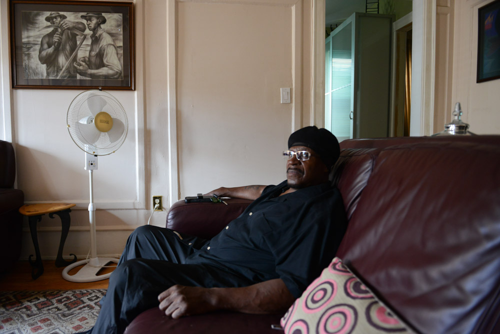 CHICAGO, ILLINOIS. Anthony Holmes, a former Gangster Disciples leader and the first known victim of electrotorture carried out by former Chicago Police Commander Jon Burge after he returned from Vietnam and joined the Chicago Police force, in the living room of a cousin in the Bronzeville neighborhood on the South Side on July 18, 2016.  Holmes was severely electrotortured in 1973 until he confessed to a murder he says he did not commit; released from jail 30 years later long after statute of limitations expired, he works now as a newspaper delivery man.