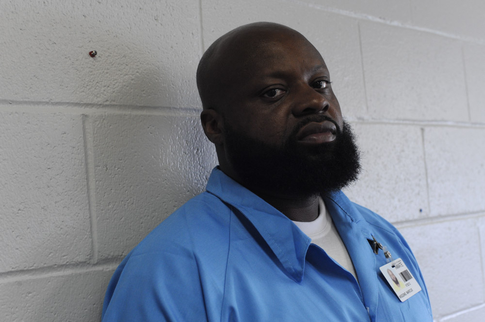 ROBINSON, ILLINOIS. Marcus Wiggins, who was beaten and electrotortured by several Chicago Police detectives working under Commander Jon Burge at Area 3 in September 1991, sits in an administrative office of the Robinson Correctional Center on August 10, 2016.  Wiggins received a $95,000 settlement which did not end his troubles as the same group of officers sought to pin two more murder cases on him, the first having been when he was tortured age 13, the second was thrown out of court by  the judge who called the case flimsy and the third attempt of the same group of officers was successful when the case landed in front of Judge Dennis Dernbach, a former Assistant State's Attorney who worked on Area 2 cases when Burge was Commander there.