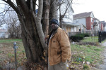 CHICAGO, ILLINOIS. Marvin Reeves, 56, stands near the front of the house he bought for his daughter in the Greater Grand Crossing neighborhood on November 29, 2015.  Reeves purchased and renovated the house with money he received in settlement from the City of Chicago after a codefendant, Ronald Kitchen, and he were both tortured and Kitchen confessed to a crime both were innocent of; Reeves spent 21 years incarcerated from 1988-2009 for a South Side arson that killed two women and three children and had received five consecutive life sentences.