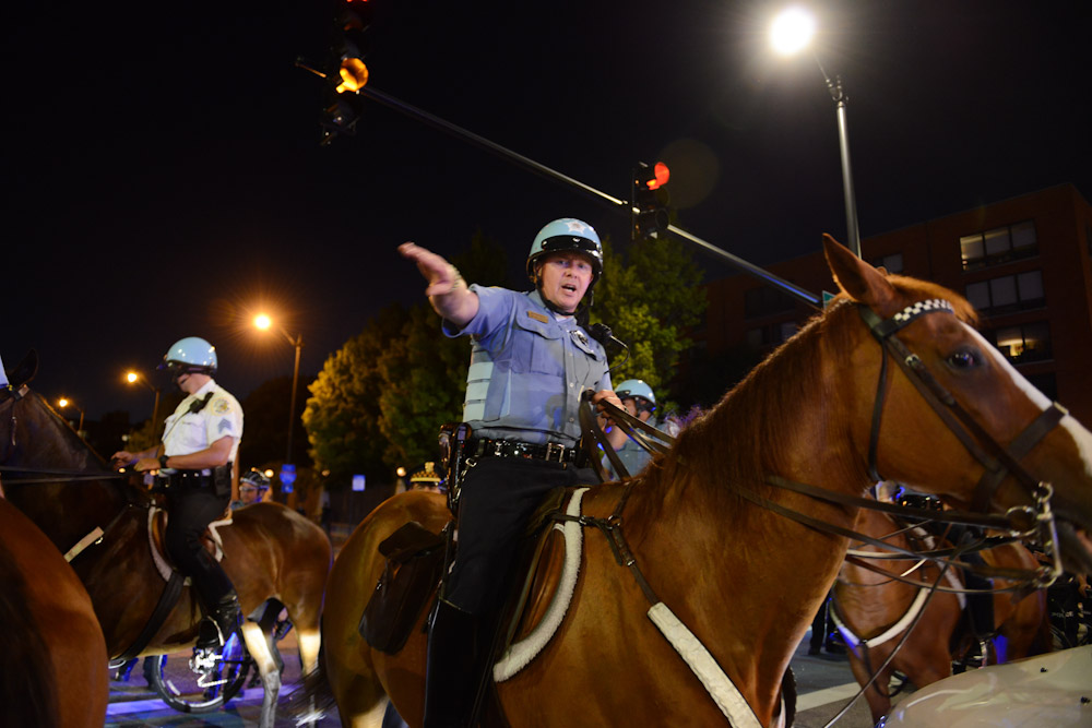 CHICAGO, ILLINOIS.  Police end a sit in by charging at demonstrators with horses at the intersection of Roosevelt and State Street in the South Loop on July 9, 2016. Protests erupted nationwide following the police shootings of Alton Sterling who was selling bootleg DVDs outside a convenience store in Baton Rouge, Louisiana and Philando Castile during a routine traffic stop for a broken tail light in the St. Paul, Minneapolis suburb of Falcon Heights; on Thursday night, a lone gunman Micah Johnson fired and killed five police officers and injured several others during a Black Lives Matter protest in Dallas.