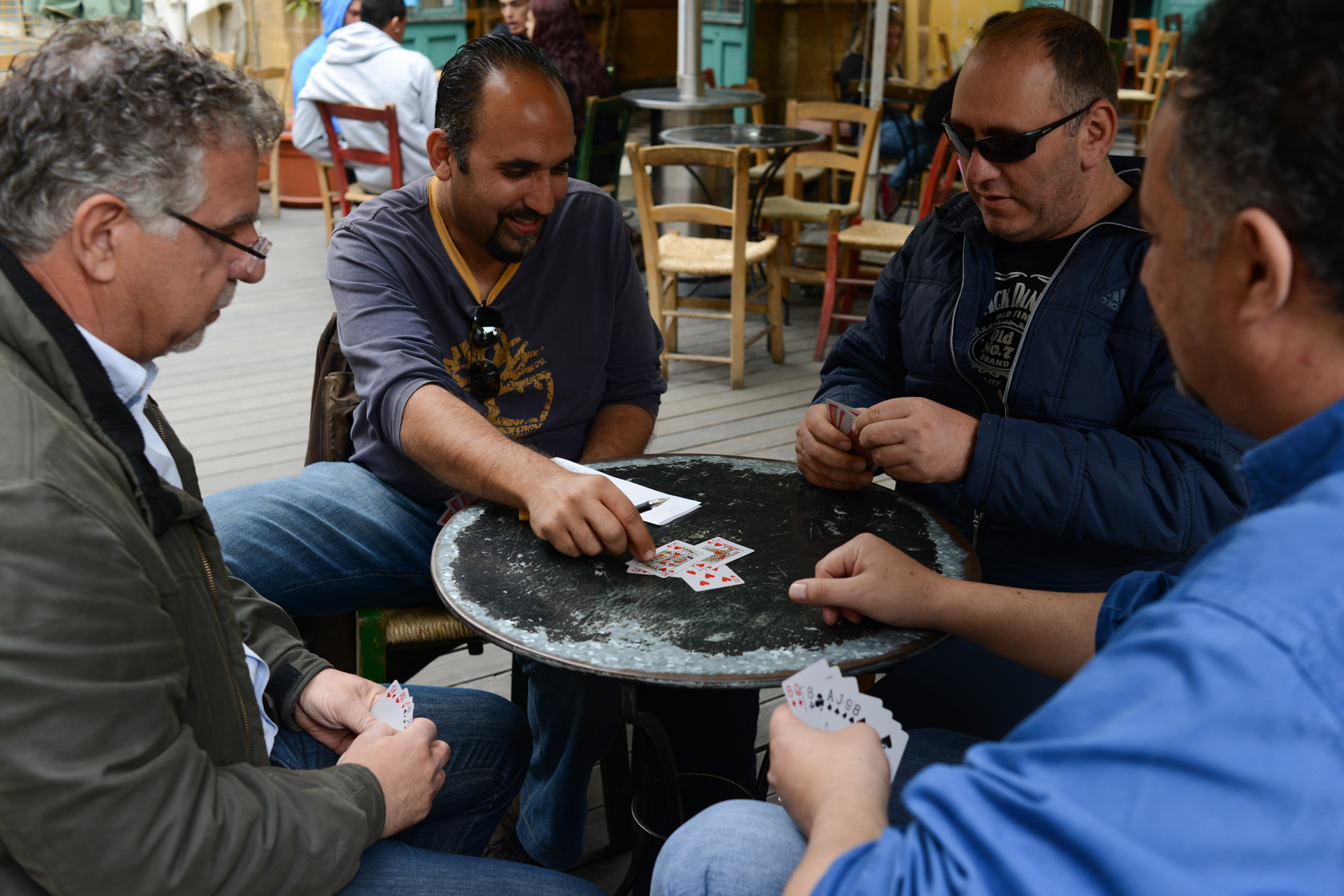 NICOSIA, CYPRUS.  (L-r) Anthoulis Myrianthous, 56, a former banker at the Bank of Cyprus, Doros Limbouris, 35, a civil engineer, Panayiotis Markou, 44, an employee at the Bank of Cyprus and George Tsountas, 44, a civil engineer, sit around and play the card game pilota at the Cafe Kala Kathoumena in the old city since their jobs are on hold until the banks reopen on March 26, 2013.