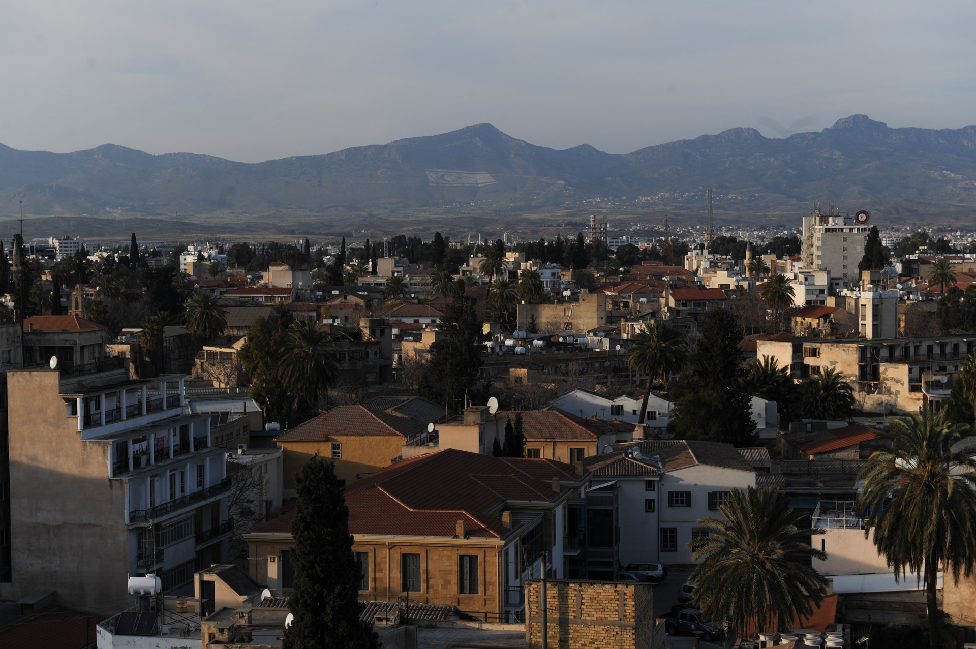 NICOSIA, CYPRUS.  A view of Nicosia and the Turkish-occupied northern half of the city and Cyprus is seen from the roof of the Holiday Inn on March 25, 2013.  The mountain on the Turkish side has the flag of the Turkish Republic of Northern Cyprus emblazoned on its side with stones, which lights up at night and is visible from across the border in the Greek-speaking southern half of Cyprus.