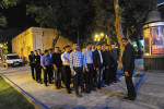 BAKU, AZERBAIJAN.  Plain clothes police officers line up in formation after managing security during the Eurovision Fan Club concert on the Bulvar seaside promenade on April 29, 2012.