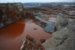 AJKA, HUNGARY.  The rupture in the toxic red alumina sludge reservoir as seen from the top of a remaining piece of the reservoir's wall at the MAL plant on November 22, 2010, that sent a torrent of toxic red alumina sludge pouring into the surrounding countryside, several villages including Kolontar and Devecser and resulted in the death of ten individuals, including a 14 months old baby, injured hundreds and left several families homeless.