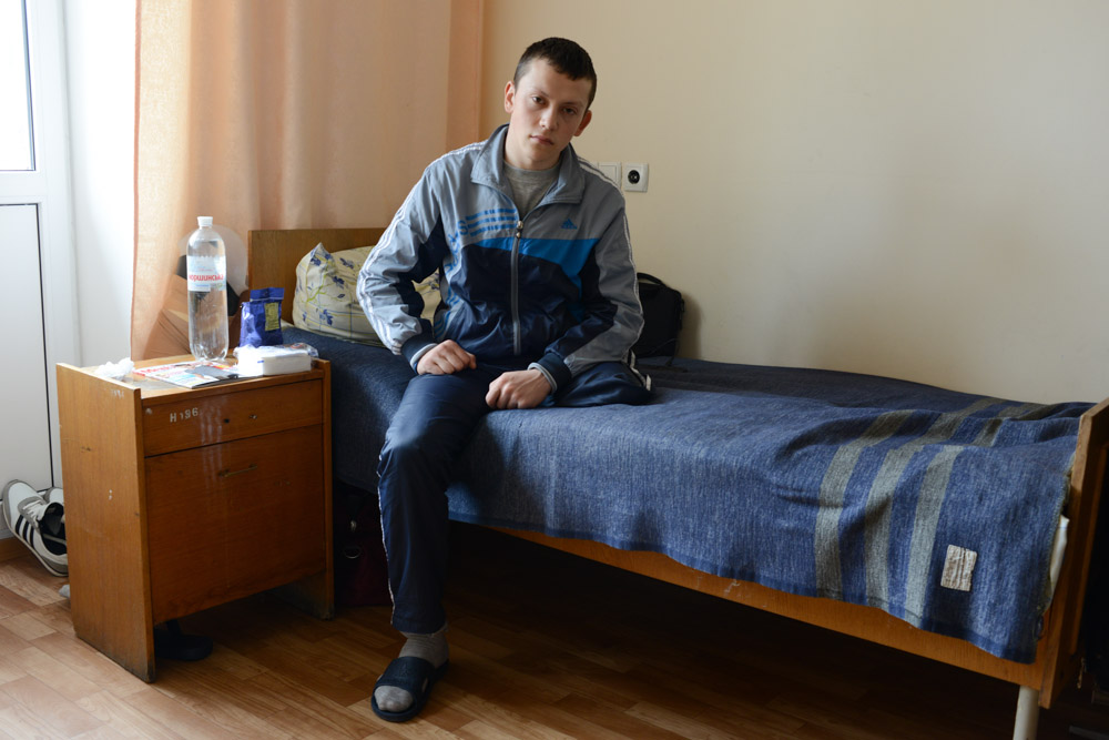 REFAT, 19Refat, 19, a Ukrainian soldier from Crimea, sits on his hospital bed at the Main Military Clinical Hospital of the Ministry of Internal Affairs in Kiev, Ukraine on April 8, 2014.  Refat was shot in the left knee by a sniper on February 20, 2014 while trying to maintain a line of soldiers on orders and had the lower part of his left leg amputated from above the knee.{quote}We had orders to stand in the line.  In the morning, it was quite calm and silent and then the protesters started to attack and they threw a grenade and I walked away from there and then I felt a sniper's bullet in my knee.  It was the morning of February 20 and we were unarmed.  I was standing with just a shield.  That morning there was shooting from both sides.  The criminal case is still open and nobody knows why they were shooting.  I blame the president.  I want a normal president and stability to come to Ukraine.  I want to stay in Kiev and enter the main university and study law.  I want to become a prosecutor.  I want things to be calm here in Ukraine.{quote} -Refat