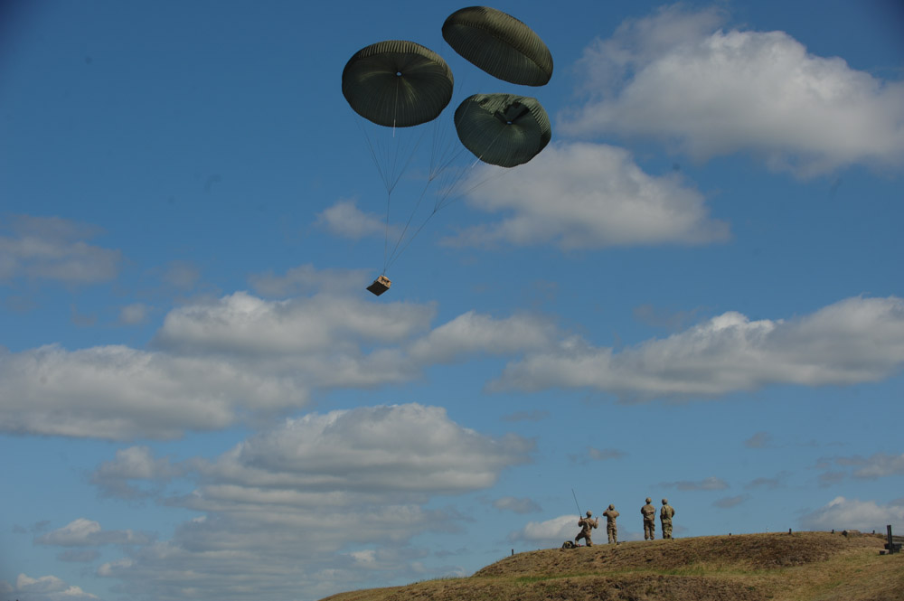 DRAWKSO POMORSKIE TRAINING AREA, POLAND.  American soldiers from the Fourth of the 319th Airborne Field Artillery Regiment of the 173rd Airborne Brigade Combat Team monitor as a howitzer drops from a C-17 aircraft that took off from Nuremberg, Germany before American soldiers parachute to the ground on June 15, 2015.  NATO is engaged in a multilateral training exercise {quote}Saber Strike,{quote} the first time Poland has hosted such war games, involving the militaries of Canada, Denmark, Germany, Poland, and the United States.