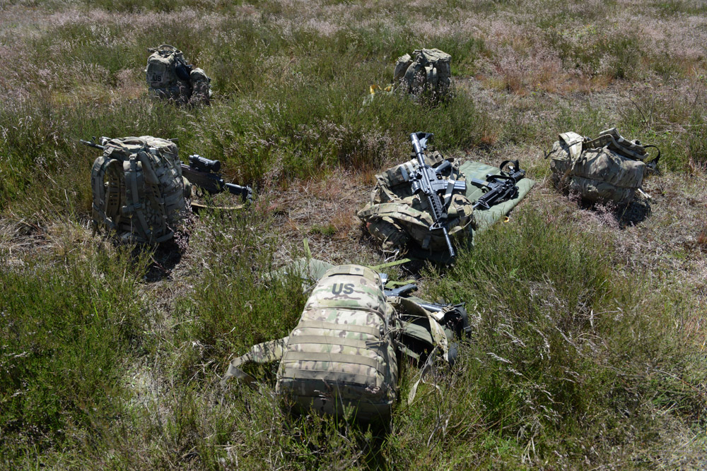 DRAWSKO POMORSKIE TRAINING AREA, POLAND.  Backpacks belonging to the paratroopers of the Fourth of the 319th Airborne Field Artillery Regiment of the 173rd Airborne Brigade Combat Team lay on the ground following an airdrop from a C-17 aircraft that took off from Nuremberg, Germany and dropped on June 15, 2015.  NATO is engaged in a multilateral training exercise {quote}Saber Strike,{quote} the first time Poland has hosted such war games, involving the militaries of Canada, Denmark, Germany, Poland, and the United States.