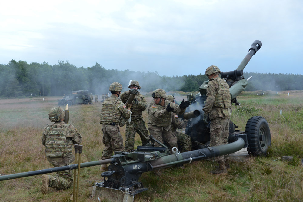 DRAWSKO POMORSKIE TRAINING AREA, POLAND.  American soldiers with the 173rd Airborne load and fire an M119A3 howitzer on June 18, 2015.  NATO is engaged in a multilateral training exercise {quote}Saber Strike,{quote} the first time Poland has hosted such war games, involving the militaries of Canada, Denmark, Germany, Poland, and the United States.