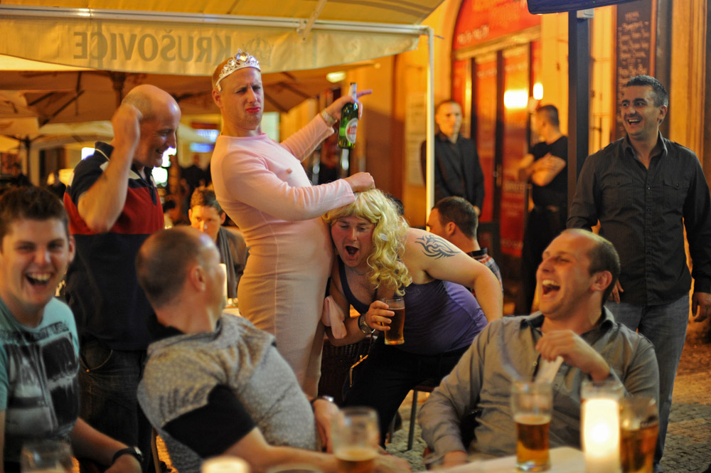 PRAGUE, CZECH REPUBLIC.  Friends and family hold a stag party for Lee Meynell (not pictured), 28, of Middlesbrough, England two weeks ahead of his wedding day at a bar in the Main Square on August 5, 2011. Stag, or bachelor, tourism in Central and Eastern Europe is a popular and low cost alternative to holding similar festivities in the U.K., bringing hordes of drunken British men into main squares and bars across the region, drawing complaints from local women.