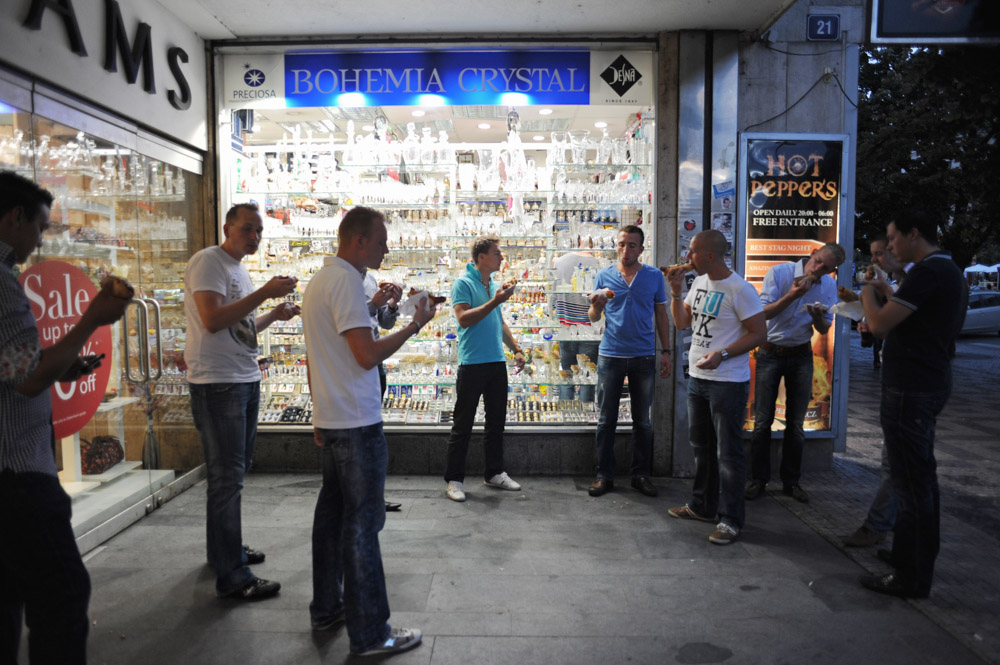 PRAGUE, CZECH REPUBLIC.  Stag tourists from Rotterdam, The Netherlands celebrating the upcoming marriage of Michael Klos, 23, eat hot dogs on the street outside a shop following a day of heavy drinking and before an even bar crawl on Weneslaus Square on August 12, 2011.