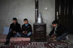 GUVECCI, TURKEY.   Syrians who fled from the year old rebellion against the rule of Bashar Al Assad in neighboring Syria sit in the home of a relative just across the border on February 27, 2012.  Turkey has seen a continued influx of refugees from the Syrian conflict and border towns like Guvecci have watched as their populations have more than doubled.