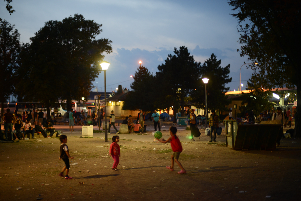 BELGRADE, SERBIA.  Children play in the middle of the encampment set up by refugees and migrants in the park by the rail and bus stations on September 4, 2015.  Thousands of refugees mainly from Syria but also Iraq, Iran and Afghanistan have made the journey from Turkey to Greece and through Macedonia before arriving in Serbia on their way to Europe in search of a better life, mainly in Germany.